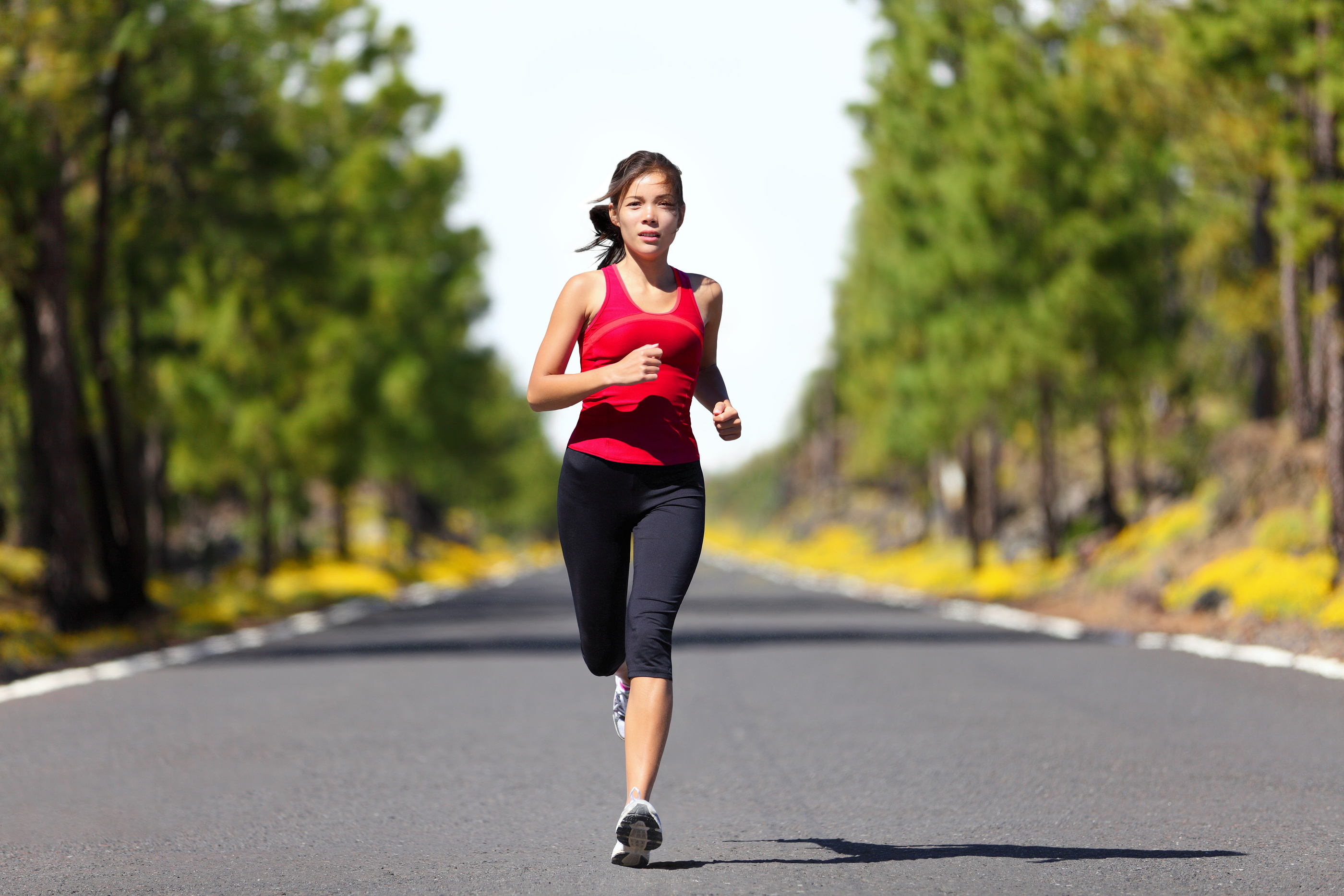 Sport fitness running woman jogging during outdoor workout. Beau